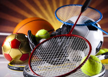 Assorted sports equipment and sunset Stock Images