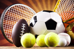 Assorted sports equipment. Sports Equipment and sunshine, vivid colorful theme royalty free stock photos