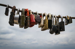 Assorted Steel Locked Padlocks and Cloudy Sky Stock Photos