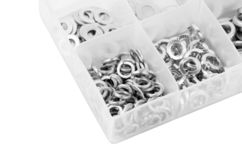 Washer in plastic organizer box. Assorted steel washer in plastic organizer box royalty free stock photography