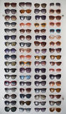 Assorted styles of tinted sunglasses on white background Stock Images