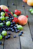 Assorted summer berries on the boards Royalty Free Stock Photo