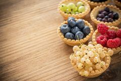 Assorted summer berries in tartlet of dough Royalty Free Stock Photo