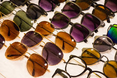 Assorted sunglasses for sale at a local market with nice discoun Royalty Free Stock Images