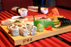 Assorted sushi. Various sushi nicely arranged on a wooden plate Stock Images