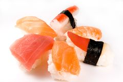 Assorted Sushi. Six assorted sushi pieces arranged in a pattern and shot against an isolated white background Stock Images