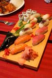 Assorted sushi 3. Various sushi nicely arranged on a restaurant table, shallow depth of field Royalty Free Stock Photo