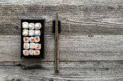 Assorted sushi on black plate Royalty Free Stock Image