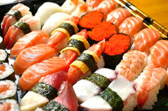 Assorted Japanese sushi. On a black plate Royalty Free Stock Image