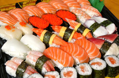 Assorted Japanese sushi. On a black plate Royalty Free Stock Images