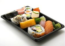 Assorted sushi lunch. Sushi lunch with salmon, scallop and more in a box for takeout, on white Stock Photography