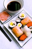 Assorted sushi on plate. Sushi meal with maki-suhi, unagi-sushi, sushi with caviar of flying fish royalty free stock image