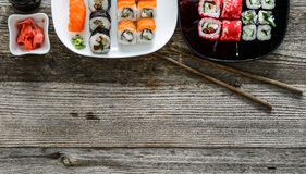 Assorted sushi on plates and a text spase Royalty Free Stock Images