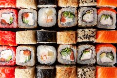 Assorted sushi rolls on black background Stock Photos