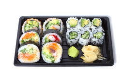 Assorted sushi rolls in a black plastic tray Royalty Free Stock Photos