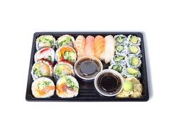 Assorted sushi rolls in a black plastic tray Royalty Free Stock Photography