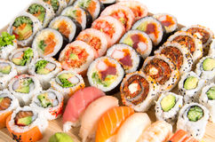 Assorted sushi rolls on a wooden board Stock Photos