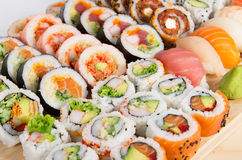 Assorted sushi rolls on a wooden board Royalty Free Stock Photography
