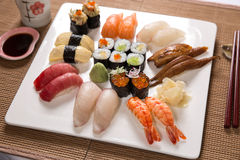 Assorted Sushi. On a white plate stock photo