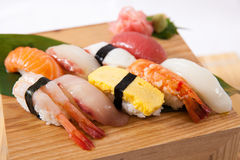 Assorted Sushi. On a wooden plate stock photography
