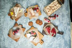 Assorted sweet desserts. Top view. Gray textured background. Beautiful serving dishes. Dessert. Food chain. Assorted sweet desserts: cake, churos, meringue roll stock photography