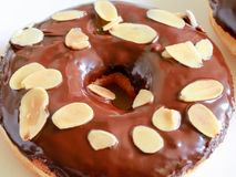 Assorted sweet donut with chocolate and almonds on top. Assorted delicious donut with chocolate and almonds on top Stock Photo