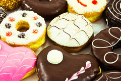 Assorted sweet donuts. Close up Assorted sweet donuts royalty free stock photo