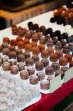 Assorted of Swiss chocolate truffles in white tray. Assorted Swiss chocolate truffles candies in white tray, milk chocolate, dark chocolate royalty free stock image