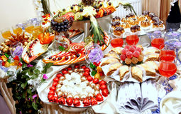 Assorted table: fruit, sweets Royalty Free Stock Image