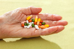 Assorted tablets in the hand of an old woman Royalty Free Stock Image