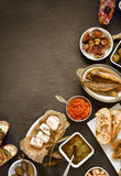 Assorted Tapas on Plates on Wooden Table Stock Image