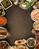 Assorted Tapas on Table with Copy Space at Center Royalty Free Stock Images