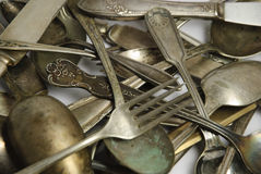 Assorted tarnished antique flatware on white Royalty Free Stock Image