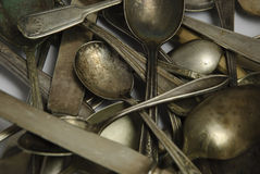 Assorted tarnished antique flatware on White Stock Image