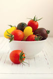 Assorted tomatoes in white bowl Stock Image