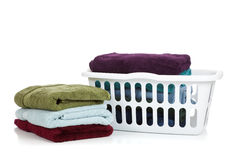 Assorted towels and basket on white Royalty Free Stock Images
