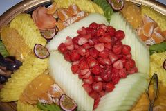 Assorted tropical fruit plate. With pineapple, melon, strawberries, passion fruit and many others stock images