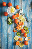 Assorted tropical fruits on blue wooden background Stock Images
