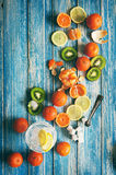 Assorted tropical fruits on blue wooden background Stock Image