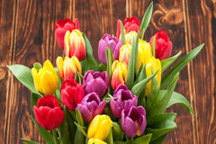 Assorted Tulips Bouquet. Burned Wooden Background. Copy Space Stock Photos