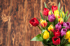 Assorted Tulips Bouquet. Burned Wooden Background. Copy Space Royalty Free Stock Photography