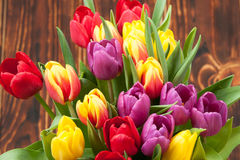 Assorted Tulips Bouquet. Burned Wooden Background. Copy Space Royalty Free Stock Images