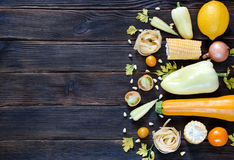 Assorted types of yellow hued vegetables. top wiev. with empty s. Assorted types of yellow hued vegetables. top wiev of pepper, corn, parsley, tomatoes, carrots Stock Photography