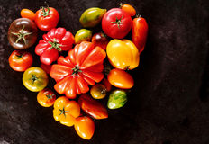 Assorted varieties of tomatoes in a heart shape Royalty Free Stock Photography