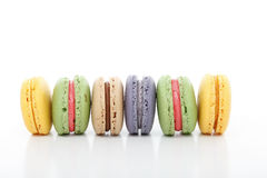 Assorted baked macarons macaroons in a row Royalty Free Stock Photos