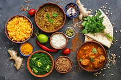 Free Assorted Various Indian Food On A Dark Rustic Background. Traditional Indian Dishes - Chicken Tikka Masala, Palak Paneer, Saffron Stock Photo - 163316040