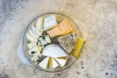 Various kind of cheese served on stone table, top view royalty free stock photography