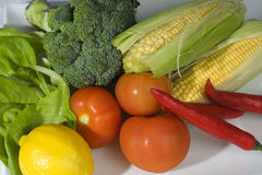 Assorted Vegetables. Consist of corn, broccoli, tomato, lemon, lettuce and chili Stock Photo