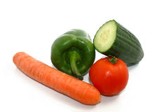 Assorted vegetables. Some vegetables, a carot, a paprika, a tomato, and a cucumber Stock Photos