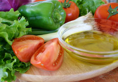 Assorted vegetables. Fresh vegetables with olive oil Stock Images